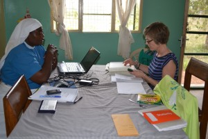 Sister Janepha and Anne working together on budgets.