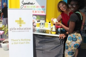 Zandra Beauty founder Zandra Cunningham (front) shows GEC executive director Anne Robinson Wadsworth the Lemon Tea Tree product line