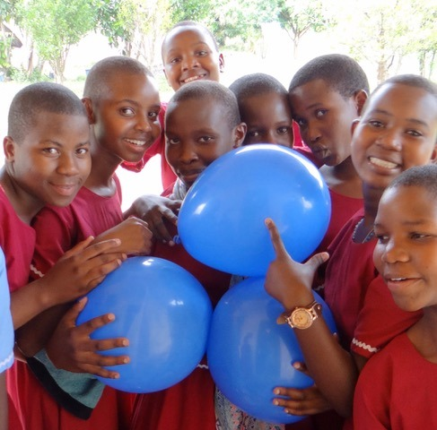 form four girls holding balloons